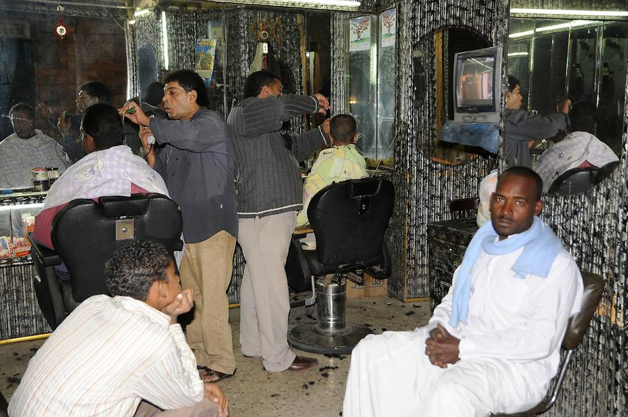 Aswan - Market at Night; Hairdresser