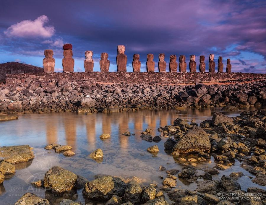 Moais of Easter Island at sunset time