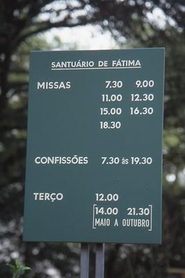 Sign indicating masses and possibilities to go to confession