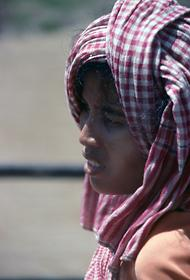 Cambodian woman with a towel wrapped around her head.