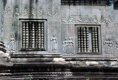 The reliefs are interrupted by dummy-windows with turned stone bars.