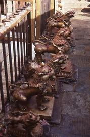 The inner sanctuary is protected spiritually by bronze lions