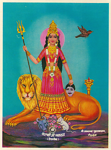 Karni Devi as Durga with caption shri karniji maharaj deshnok. The small head of a buffalo at her feet refers to the skull of Yama