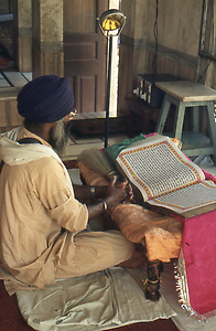 Reading from the holy book Guru Granth Sahib at many places in the area of the Temple