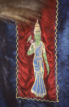 The goddess on a curtain of the litter in which she is carried in the night to her consort Shiva