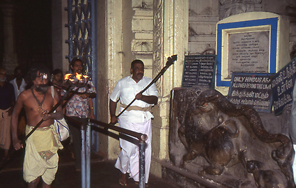 The temple servants leave the shrine, which may not be entered by non-Hindus