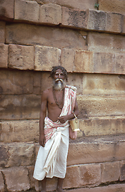 Sadhu with begging bowl in Sarnath near Varanasi / Benares, a prominent Buddhist pilgrimage site